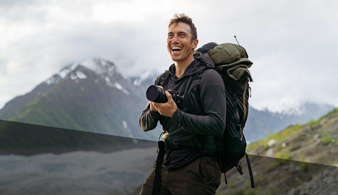 Photographer Chris Burkard smiling with his camera