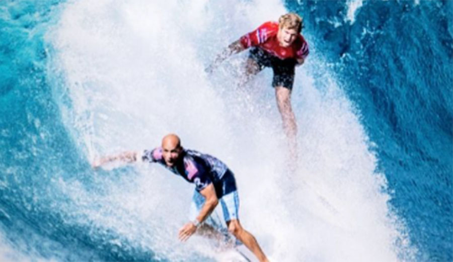 Kelly Slater and John John Florence surfing at Pipe Masters