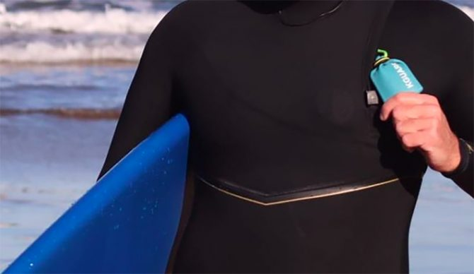 A waterproof pouch to carry an electric car key into the surf