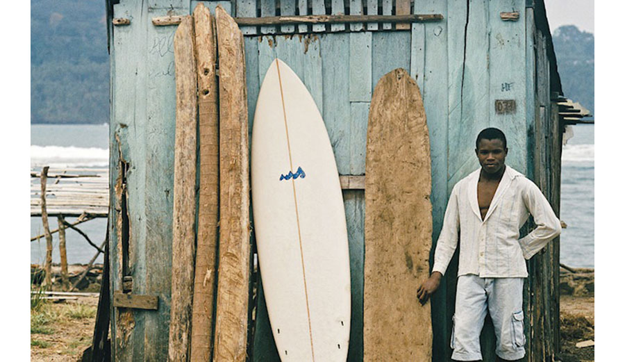man in front of african surf boards