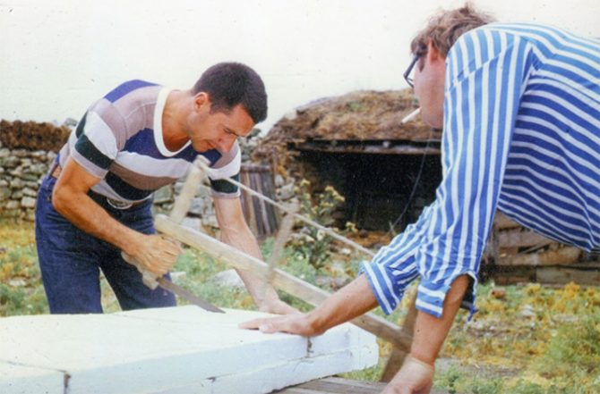 Nikolai Petrovich Popov and Vladimir Prozorovsky working on their first surfboard and