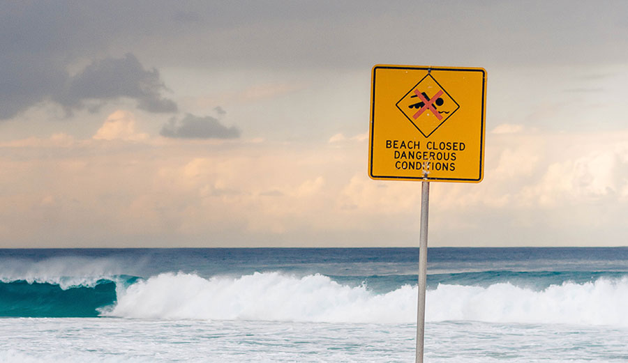 Beach closed sign on beach