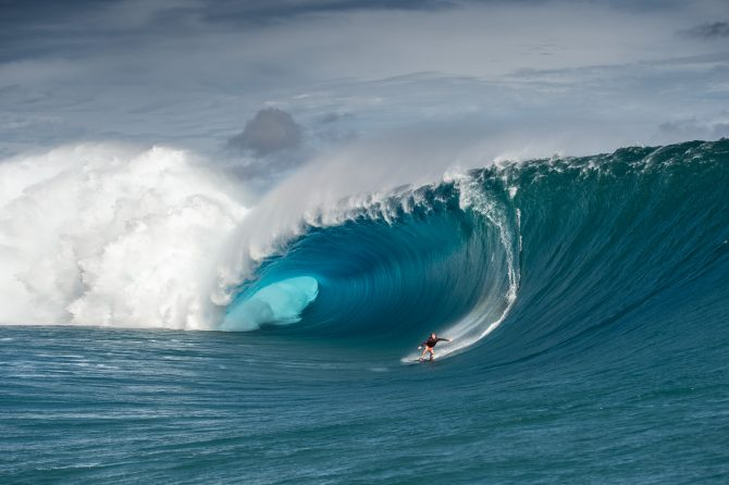 Mark Healey riding down the face of a wave.