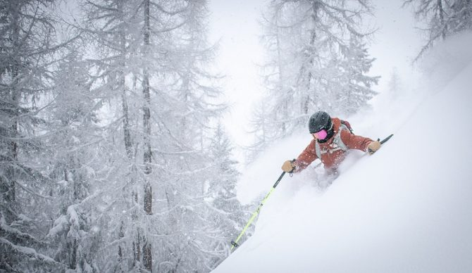 alex lange via unsplash powder skiing deep