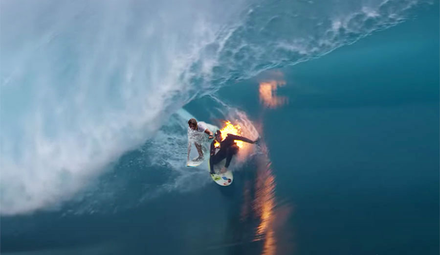 two surfers in barrel at Teahupoo