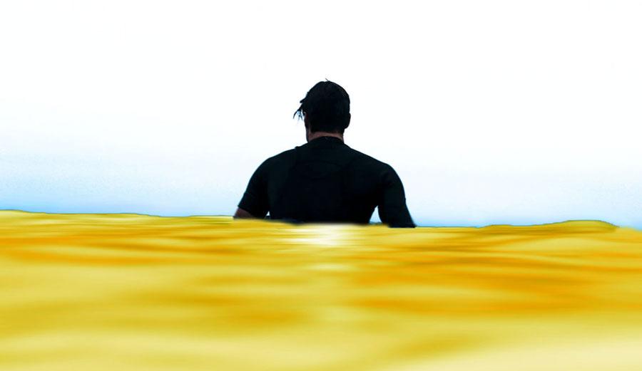 Man sitting in yellow water