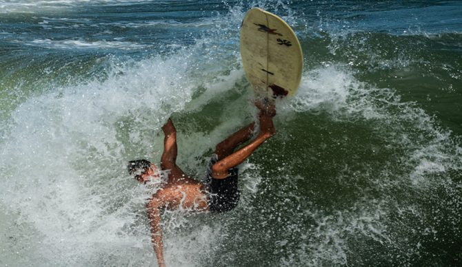 a surfer wipes out in Florida