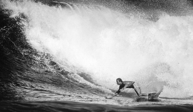 Simon Anderson, bottom turning on a big wave