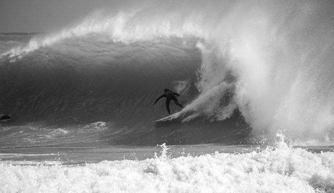 A surfer rides a barrel in Miami