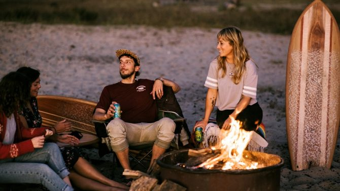 ryan lynch and friends around a bonfire, timber surf co