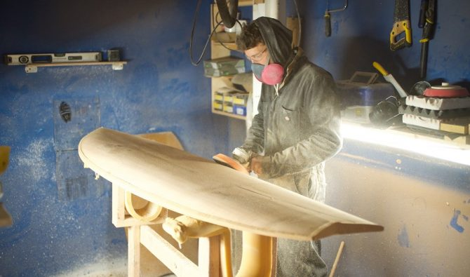 ryan lynch of timber surf co shaping a board