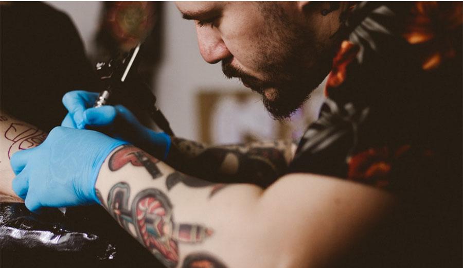 Tattoo Artist tattooing