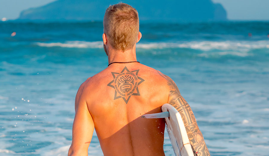 surfer with tattoos