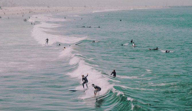 surfers at venice beach unsplash victoria palacios