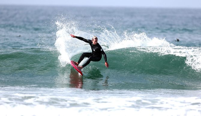 Colin McPhillips rides a wave on a Gerry Lopez board