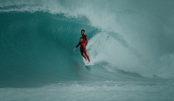 Filipe Toledo rides a barrel