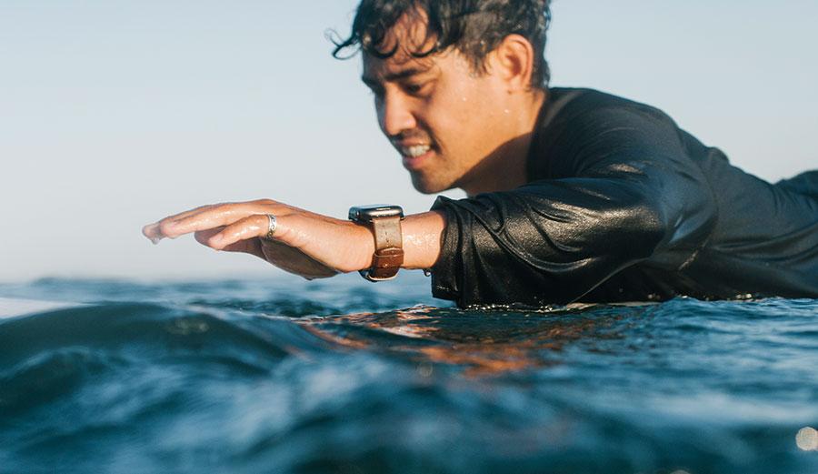 Apple Watch on surfer