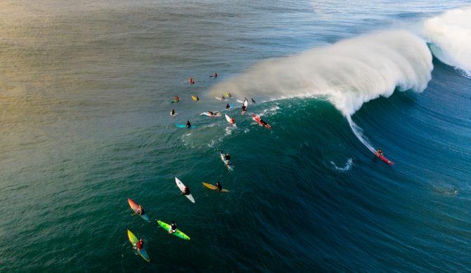 surfers at waimea bay, HI
